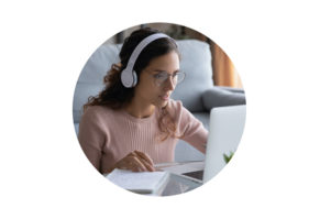 woman on laptop with headphones on